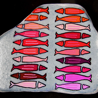 red and pink fish painted with acrylic paint pens on rock