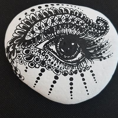 eye drawn on rock