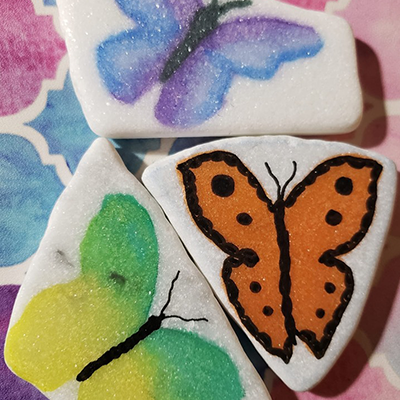 butterfly watercolor on white stone