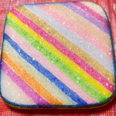 colorful vivid markers on white sparkly stone