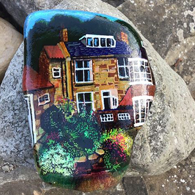 rock painting of old brick building
