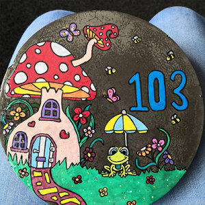 mushroom house 103 painted with acrylic paint pens on rock