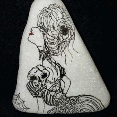black micron fineliner drawing on white rock