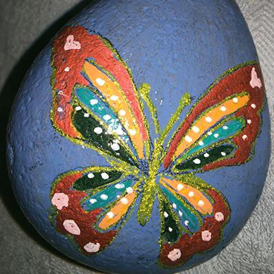 metallic butterfly on rock