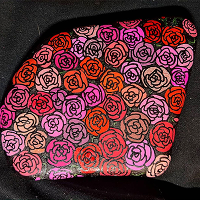 red and pink flowers drawn on rock