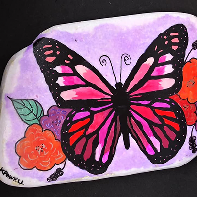 pink and red butterfly painted on white santorini stone