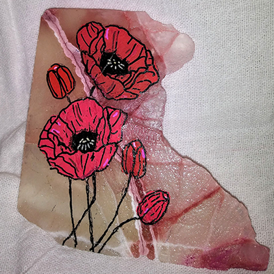pink and red poppy flower painted on honecomb calcite rock